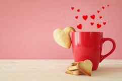 Cup of coffe and heart shape cookies Royalty Free Stock Image