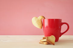 Cup of coffe and heart shape cookies Stock Image