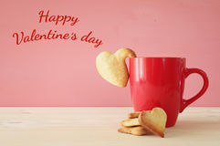 Cup of coffe and heart shape cookies Stock Photos