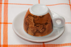 Cup for coffe on the kitchen tablecloth.  Stock Images