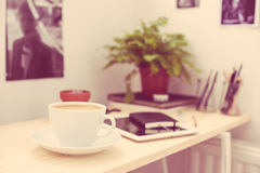 Cup of coffe in modern loft-style office Stock Images