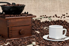 Cup of coffe and old grinder Stock Image