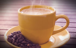 Cup of coffe. Over wooden table royalty free stock photography
