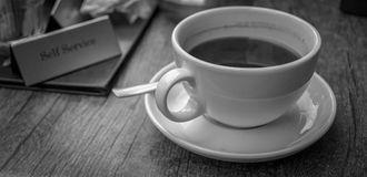 A cup of coffe for pause. A cup of coffe in B/W. Artisitic view for something we need every day Royalty Free Stock Image