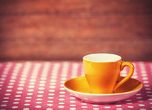 Cup of a coffe on polka dot cover Royalty Free Stock Photo