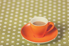 Cup of a coffe on polka dot cover. Stock Photography