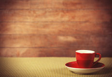 Cup of a coffe on polka dot cover. Royalty Free Stock Photo
