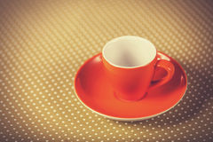 Cup of a coffe on polka dot cover. Royalty Free Stock Image