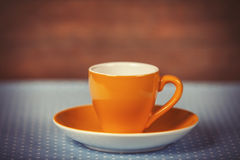 Cup of a coffe on polka dot cover. Stock Images