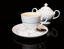 Cup of coffe and sugar bowl on black background Stock Photo