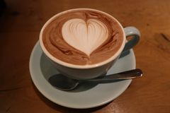 A cup of coffee with heart symbol royalty free stock photo