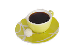 A cup of coffe with a sweet on white background. A cup of coffe with a coconut sweet on white background Stock Images