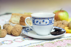 Cup of coffe with wanuts. And porcelian Stock Photo