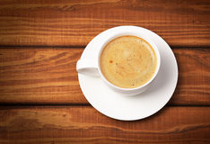 Cup of coffe on wooden background. Stock Photography