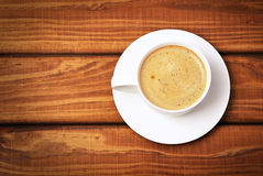 Cup of coffe on wooden background. Concept photo Royalty Free Stock Photo