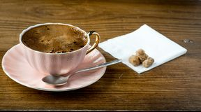 Cup of coffe on wooden table Royalty Free Stock Images
