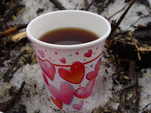 Cup of Coffee. In a Paper Heart printed cup...taken while out having a lunch in the woods Stock Image