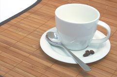 Cup of coffee. On a wood background Stock Photography