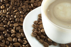 Cup of coffee. White cup of coffee on the brown seed stock images
