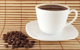 Cup of coffee. A cup of coffe with brown seed near royalty free stock photography