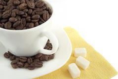 Cup of coffee. With seed and sugar pieces royalty free stock images