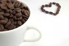 Cup of coffee. With seed and heart from it stock images
