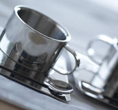 Cup of coffee. Metallic cup of coffee(café) on a table of breakfast Royalty Free Stock Images
