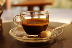 Cup of coffee. Glass cup of coffee with the piece of lump sugar Stock Photo
