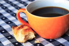 Cup of coffee. On blue and white gingham tablecloth Stock Photo