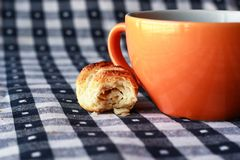 Cup of coffee. On blue and white gingham tablecloth Stock Photos