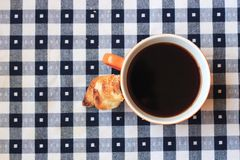 Cup of coffee. On blue and white gingham tablecloth Stock Images