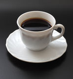 Cup of coffee. Cup of coffee on a black background Stock Image