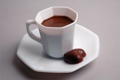 Cup of coffee. And chocolate in the form of heart Royalty Free Stock Photography