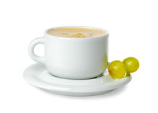 Cup of coffee. And grapes over white background royalty free stock photo