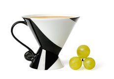 Cup of coffee. And grapes over white background stock images