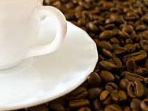 A cup of coffee. And coffee beans royalty free stock photo