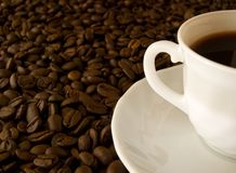 A cup of coffee. And coffee beans royalty free stock image