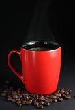 Cup of coffee. Cup of coffe and some coffe beans around it stock images
