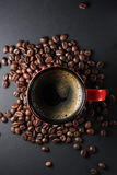 Cup of coffee. And some coffee beans around it Royalty Free Stock Images