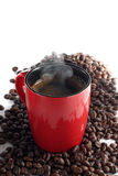 Cup of coffee. Cup of coffe and some coffe beans around it stock image