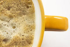 Cup of coffee. Close-up of a cup of coffee with foam. Focus is on the froth Royalty Free Stock Images