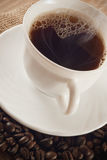 Cup of coffee. With coffee beans around Royalty Free Stock Images