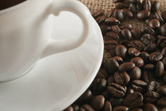 Cup of coffee. With coffee beans around stock photo