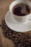 Cup of coffee. With coffee beans around royalty free stock photography
