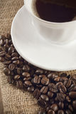 Cup of coffee. With coffee beans around stock images