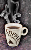 Cup of Coffee. Hot smoking coffee served in a white cup Stock Photo