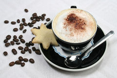 Cup of Coffee. Cup of hot coffee with cream, coco and cake Stock Photos