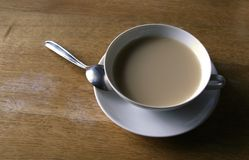 Cup of coffee. With a little spoon Royalty Free Stock Image