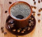 Cup of coffee. On a wooden table Royalty Free Stock Images