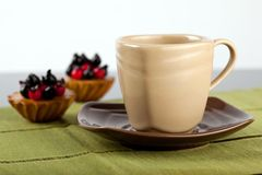 A Cup of coffee and 2 mini turtas. A Cup of coffee and 2 mini tarts (or tea Royalty Free Stock Image